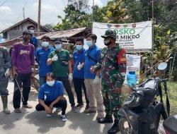 Kompak Bersama Masyarakat, Satgas Pamtas Yonif Mekanis 643/Wns Semprotkan Disinfektan Ke Sejumlah Ruang Publik
